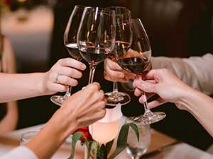 A cheers with four glasses of wine