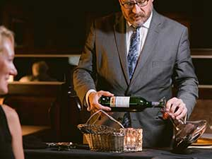 Refectory Somm pouring wine